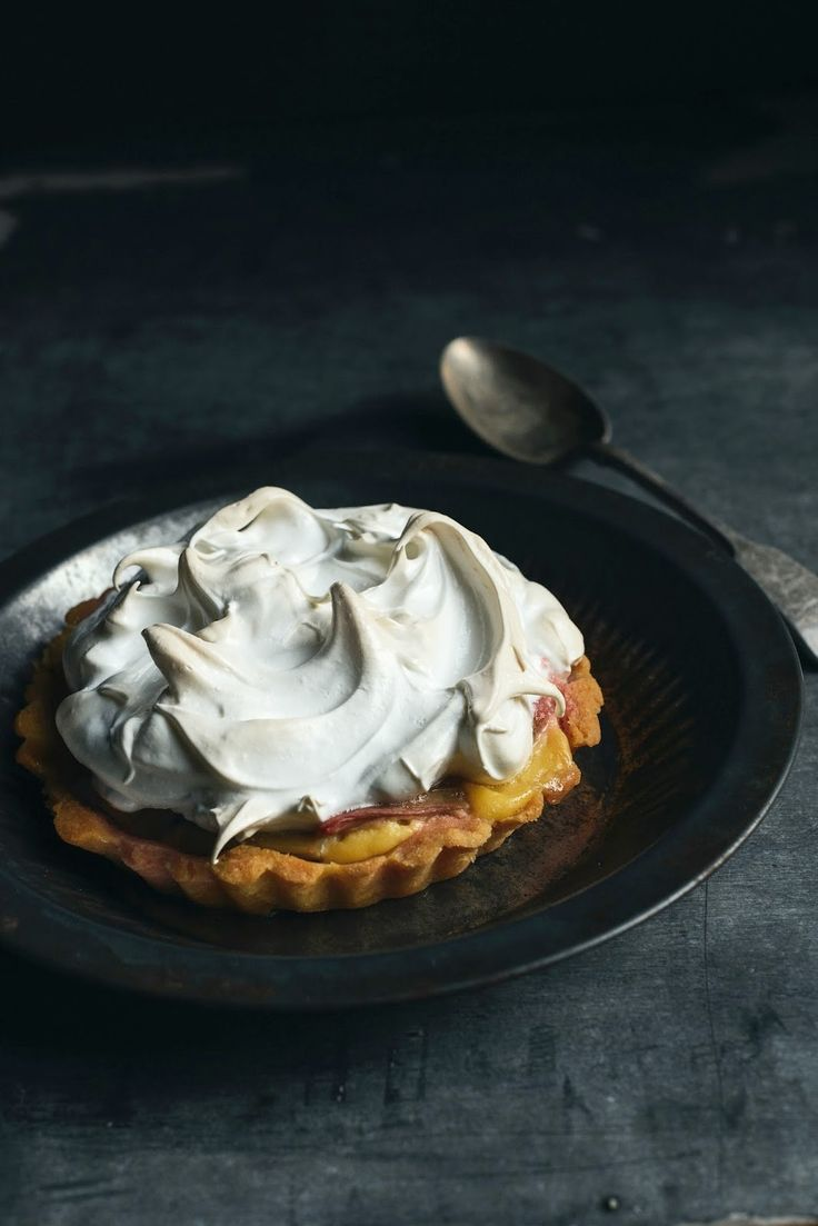 vanilla rhubarb tarts topped with meringue