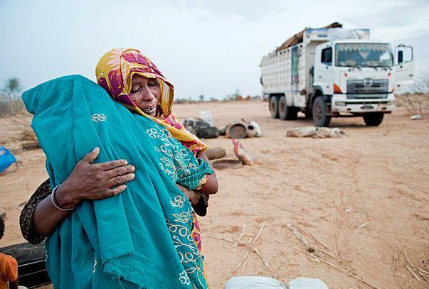 Darfur Refugees Still Fear Returning Home - Displaced people returning home in Darfur under UNHCR#039;s voluntary programme. (Photo: UN Photo/Albert Gonzalez Farran)