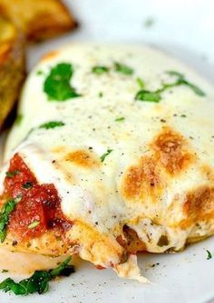 Italian Baked Pesto Marinara Mozzarella Chicken Parmesan _ takes 5 minutes to prep, has 4-ingredients, and bakes in just 30 minutes!