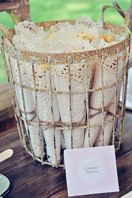 Caramel corn wrapped in white paper doilies at a Shabby Chic birthday party! See more party ideas at CatchMyParty.com!