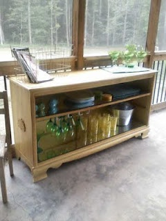 An old dresser turned into a bar for the porch/patio