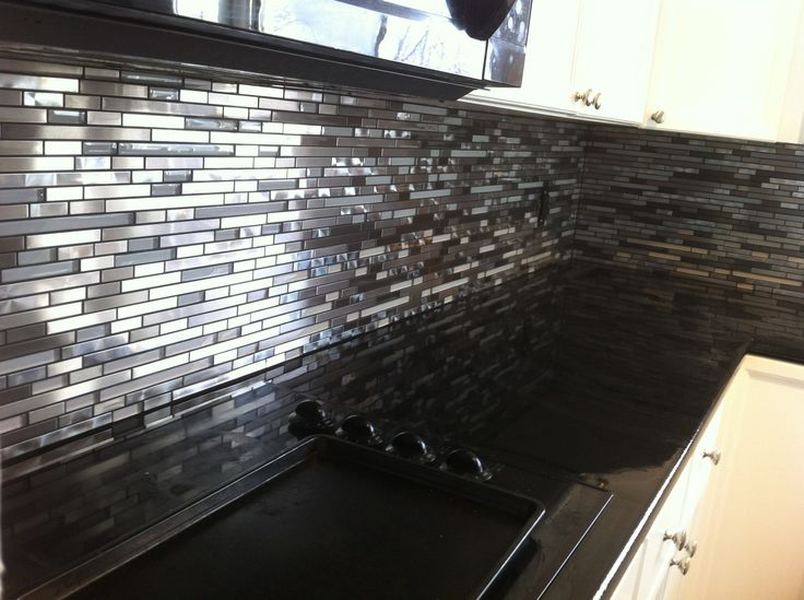 Glass And Swirled Metal Backsplash Installed By Stepping Stone Tile Sst Our Kitchen