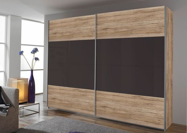 Schrank Quadra 181,0 cm Eiche Sanremo Lava 8547. Buy now at https://www.moebel-wohnbar.de/schwebetuerenschrank-quadra-181-0-cm-eiche-sanremo-mit-glas-lava-8547.html