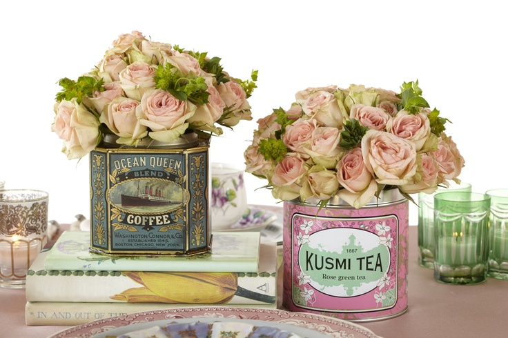 Vintage Tea Cans Filled with Pink Roses.