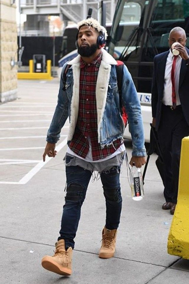 Odell Beckham Jr. wearing Amiri Shearling Destroyed Trucker Jacket, Amiri Laced Plaid Shirt, Amiri MX1 Jeans Dark Indigo, Nike Air Force 1 High 07 LV8 WB Flax Sneakers