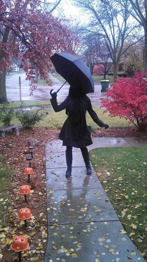 Got black morph suit, coat, boots, wig, scarf, and umbrella
