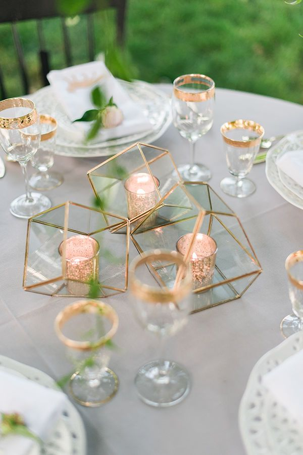 Garden Wedding Centerpiece Inspiration | This bride chose to go without flowers for her centerpieces. She simply placed a metallic votive candle inside of a gold terrarium. Perfect for the minimalist bride.