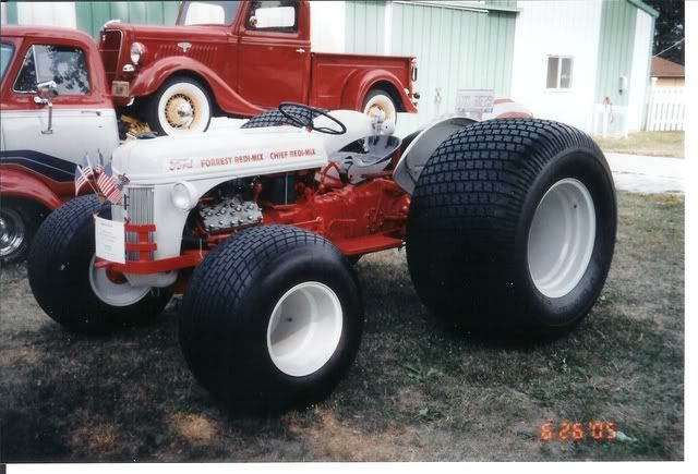 Ford 8N Tractor with a Flathead V-8 and massive turf tires...this thing is just plain cool....