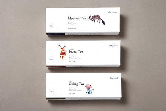 упаковка чая с иллюстрациями животных