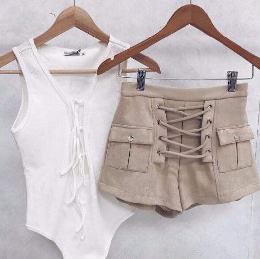 Blonde Suede Lace Up Shorts Blonde/Light Tan Currently Trending Lace-Up Front Available in four sizes Please allow 2-3 weeks for delivery…