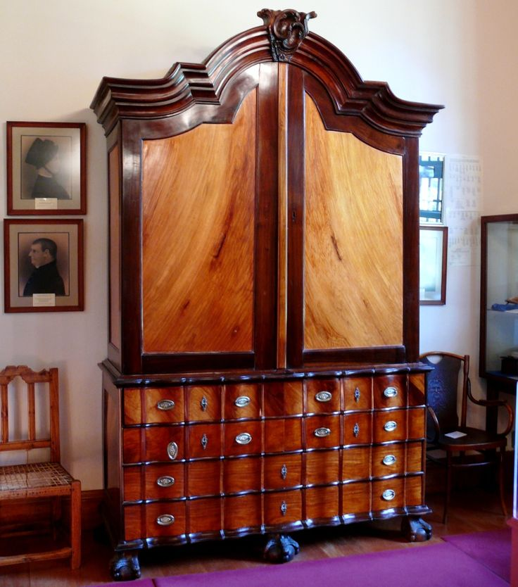 Boschendal Furniture - A yellow-wood and stinkwood armoire in the delightful Boschendal manor house with yellow-wood ceilings, floorboards and doors set in teak frames.
