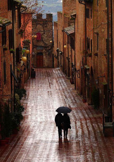 A romantic walk in the rain down the ancient, narrow, cobblestone streets of the small village of Certaldo in Tuscany, Italy