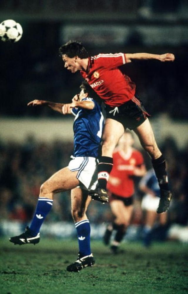 Ipswich Town 1 Man Utd 2 in Jan 1988 at Portman Road. Mike Duxbury heads clear in the FA Cup 3rd Round.