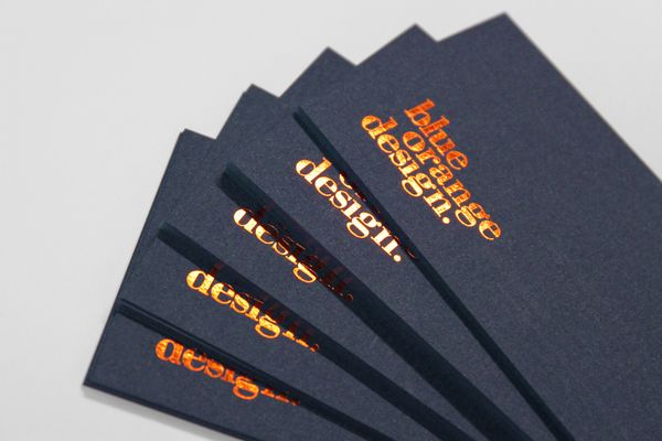 Blue Orange Design by Elie Esakoff, via Behance. Orange foil stamp on thick black stock.