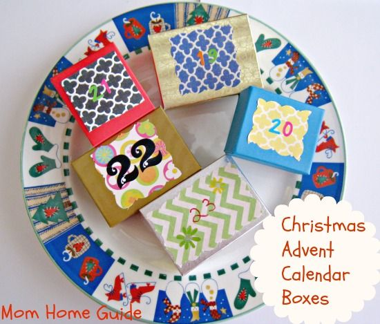 Mom Home Guide's Christmas advent calendar boxes. The boxes are for counting down the days until Christmas. The boxes can hold candy, stickers, small toys, etc. The boxes are small gift boxes decorated with scrapbook paper and stickers.#christmas #adventcalendar #momhomeguide