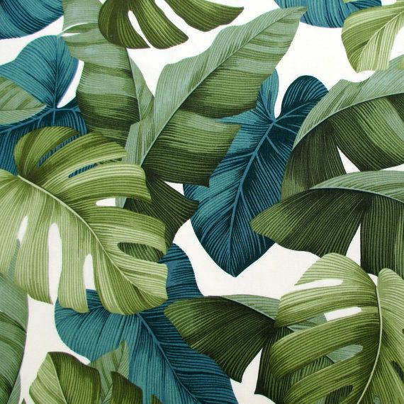 This tropical fabric, straight from Hawaii, features stylized monstera, banana, and taro leaves in shades of green, all on a natural cream