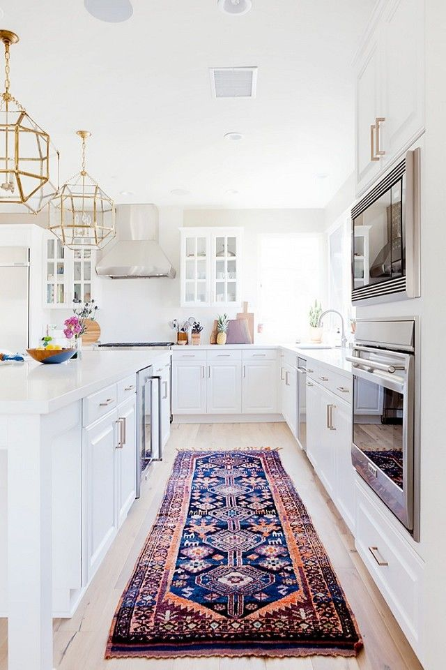 For years, kitchen floors have been left bare but interior designers are starting togive the space new attention. Runner rugs are a simple way to give an all-white kitchen an injection of...