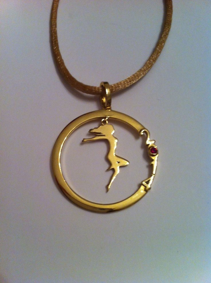 2014 Pendant in sterling silver 925 - gold plated  with red zircon on a beige silk cord.