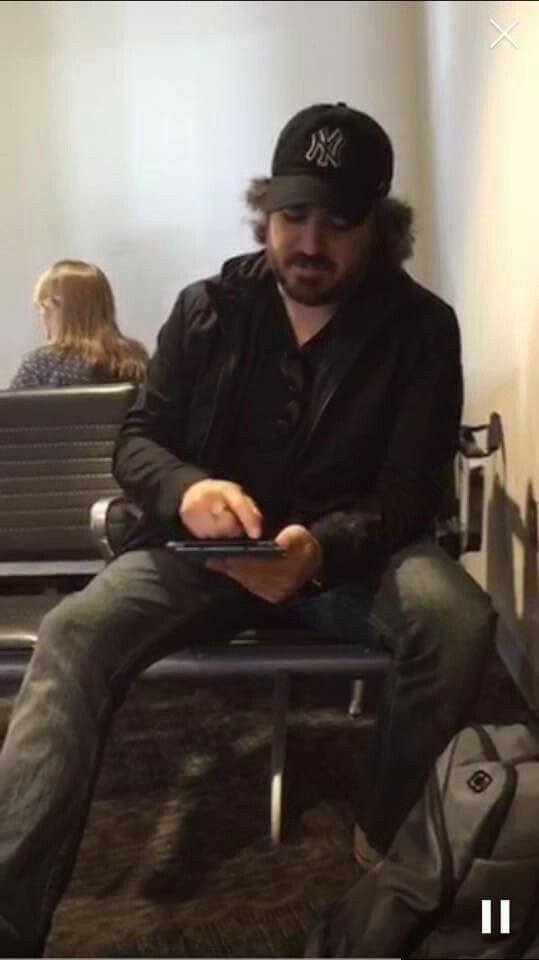 Q holding dan green's iPad