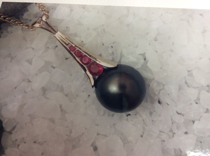 Tahitian pearl drop pendant set with an accent of rubies and a split shackle