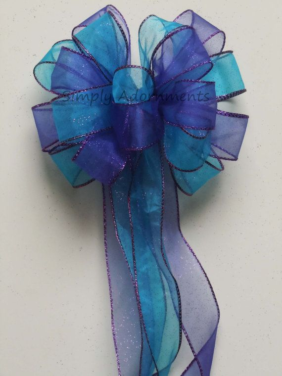 Hey, I found this really awesome Etsy listing at https://www.etsy.com/listing/178822824/purple-blue-peacock-wedding-pew-bow-aqua