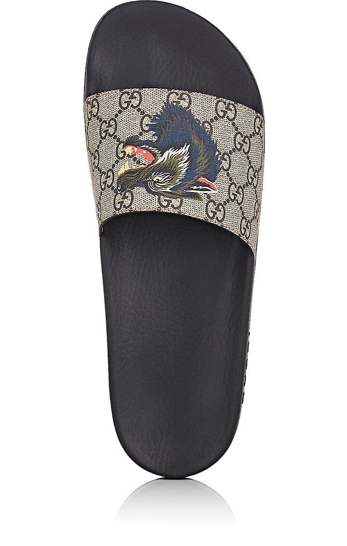 49966a12cae7  340 Gucci Pursuit Canvas Slide Sandals -SOLD BY NORDSTROM - affiliate - A  vicious wolf print adds some bite to a stylish Italian sandal built from  durable ...