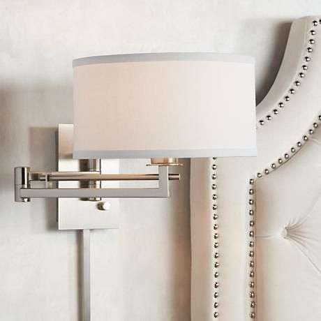 Revitalize your décor with the modern style from this sleek Possini Euro Aluno plug-in swing arm wall lamp.