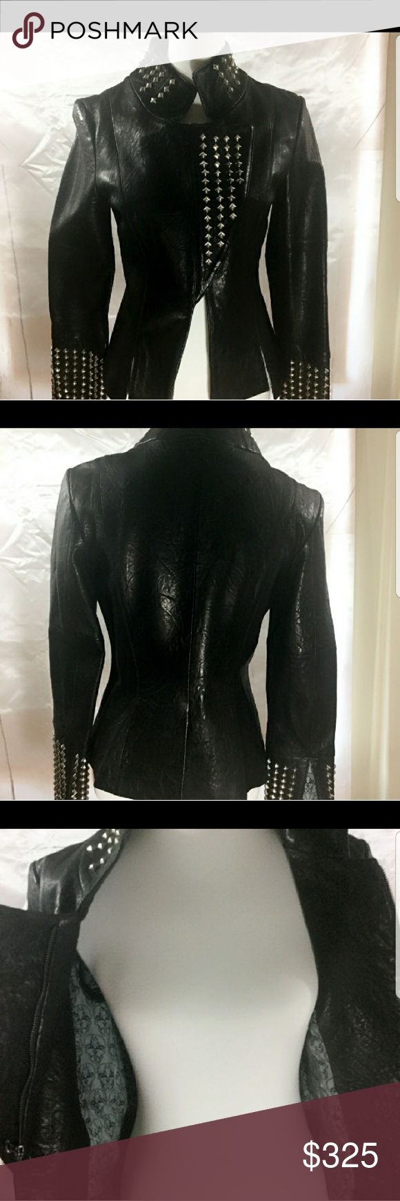 AUTH THOMAS WYLDE STUDDED LEATHER JACKET Super edgy!! Worn under 5 times. I love the style on this jacket! You will get a ton of compliments and jealous friends!! Super soft and silky lining with trademark skulls from Thomas Wylde Thomas Wylde Jackets & Coats