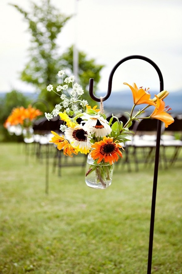 mason jar with flowers hanging from a hook.  Of course this would only work for outdoor stuff.