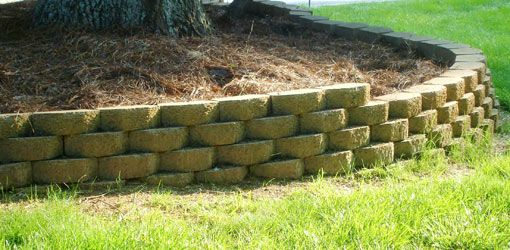 Building a raised bed with retaining wall blocks.
