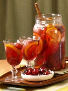 Sangria........made with red wine, 7-up, orange juice, lemons, oranges, apples, & limes. Oh, and a teensy bit of brandy:)