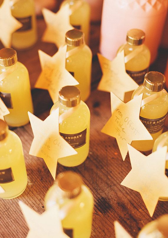What a cool way to do a DIY table card/favor combo - Homemade limencello acted as both the favors and escort cards! Moon and stars themed wedding   photo by First Mate Photo Co.   100 Layer Cake