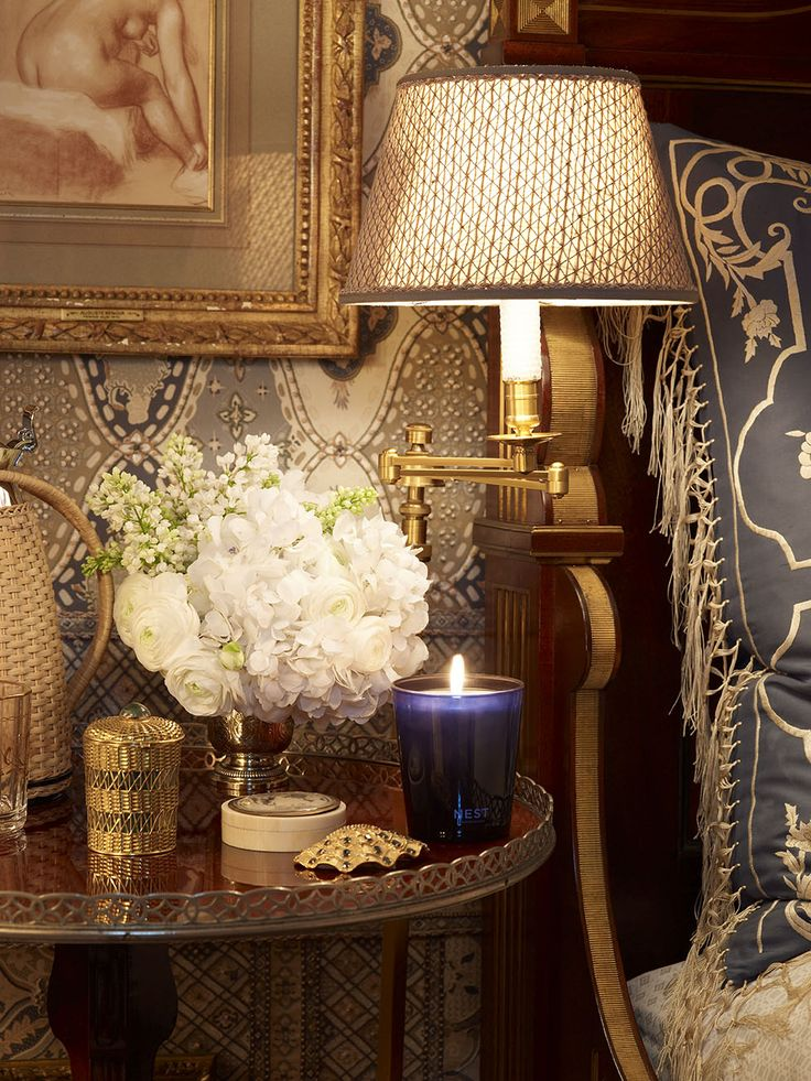 The fab wall covering, the embroidered fabric on the pillow sham, textural lamp shade and charming accent table. This is the New York bedroom of Howard Slatkin.
