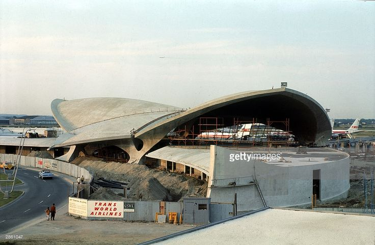 View of the construction of the TWA (Trans World Airlines) terminal, designed by Finnish architect Eero Saarinen (1910 - 1961), at Idlewild Airport (later renamed John F. Kennedy Airport), New York, New York, 1961.