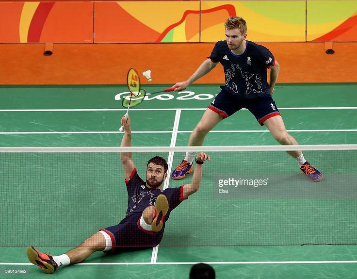 Marcus Ellis and Chris Langridge of Great Britain return a shot to Fu Haifeng…