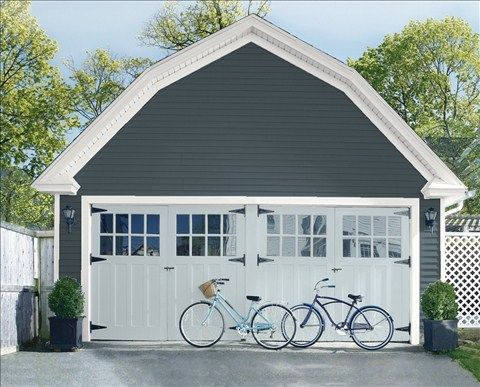 Look at the paint color combination I created with Benjamin Moore. Via @benjamin_moore. Siding: Lead Gray 2131-30; Trim: American White 2112-70; Garage Doors: Silver Gray 2131-60.