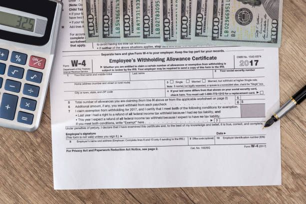 w4 tax form with money and pen