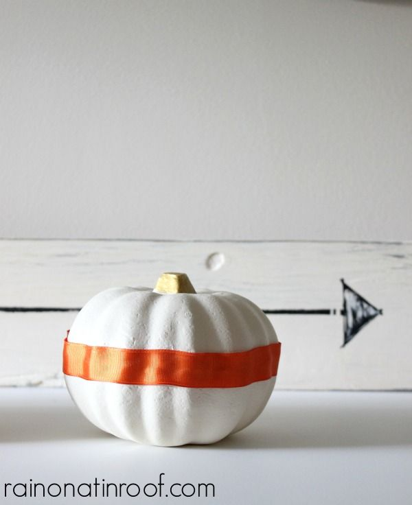 Can't believe how adorable these pumpkins are and that they originally came from the Dollar Tree! Crazy what a little time and paint will do! Dollar Tree Pumpkins Upcycle via RainonaTinRoof.com