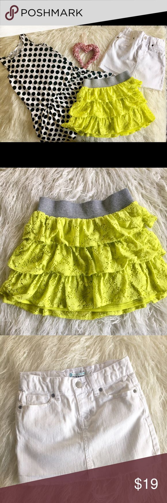 Girls Bundle two skirts and dress Bundle includes one white denim skirt with adjustable waist band, one fabric lime green with a grey elastic waist band & one white dress with black polka dots. In excellent condition size medium 7/8 Bottoms Skirts