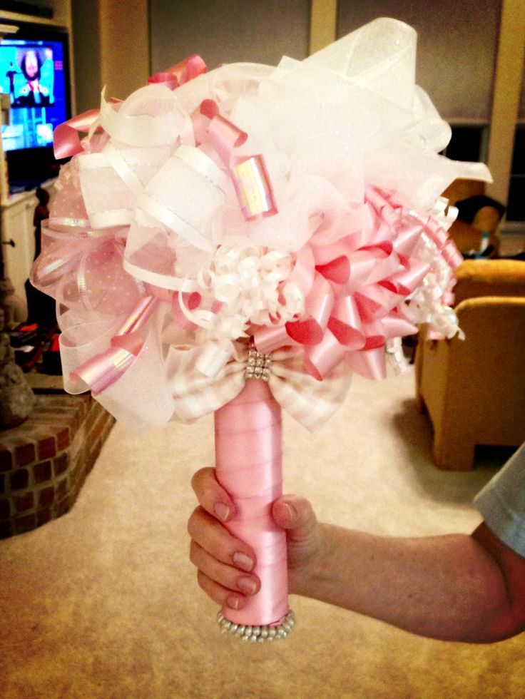 The perfect way to ditch the old paper plate rehearsal bouquet! Simple to do, paper towel tube, foam ball, a glue gun and pearl pins!