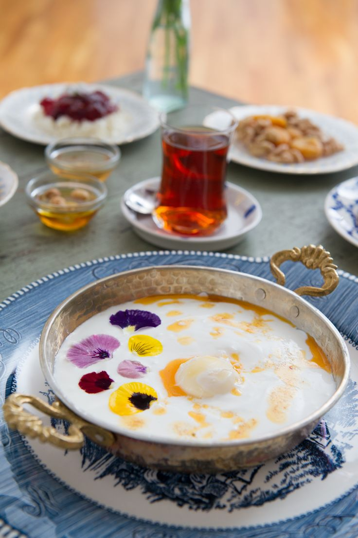 Busra Erkara's Cilbir, made with eggs, garlic yogurt, sage butter, and edible flowers. Photo by Morgan Ione Yeager for Aftertastes