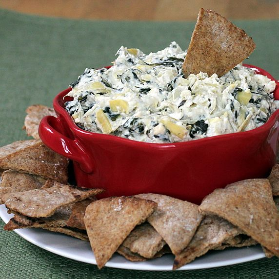 Healthy Spinach Artichoke Dip -- An easy, low calorie makeover in the slow cooker or oven!!  Makes a ton and is very yummy!