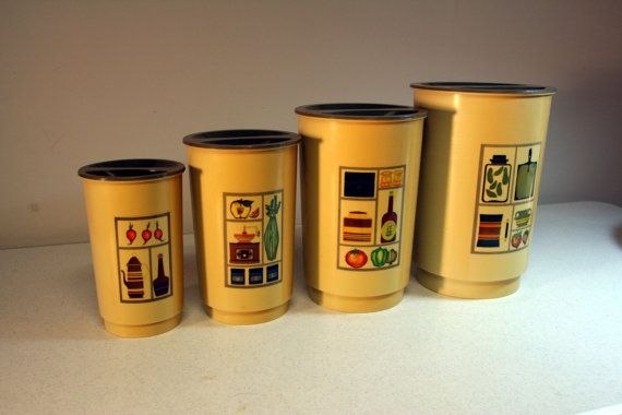 Set of 4 vintage kitchen cannisters from large to small feature retro images of pickles, veggies, coffee pots, coffee grinders etc. This set
