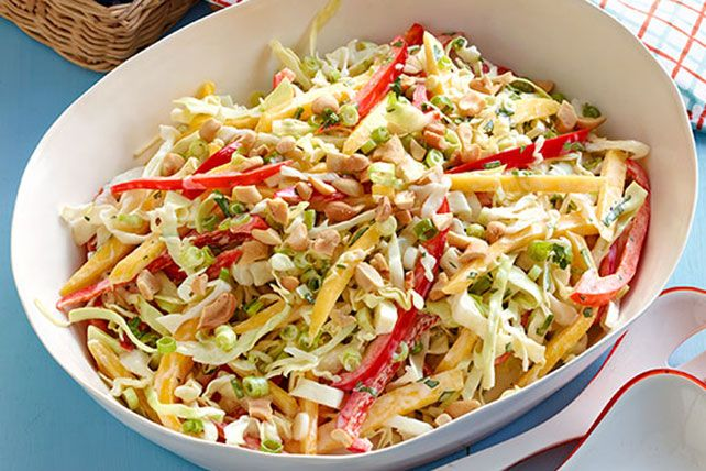 All-American coleslaw gets a tropical twist in this recipe—made with thin mango strips and chopped cashews.