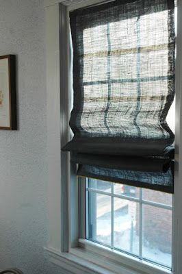 A blog post on how to make roman shades with fabric of your choice using your current (or inexpensive) vinyl mini blinds. Fabric glue holds it together, but I would probably put in a few stitches.