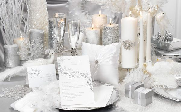 Add unique shine to your winter wedding with white invitations and accessories that sparkle with silver