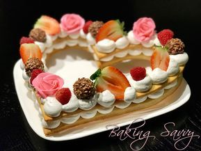 So, my Facebook feed has been flooding with this particular pastry that is two layers, has some sort of filling inside, and topped with fresh fruits. You most likely have seen it by now. I h…
