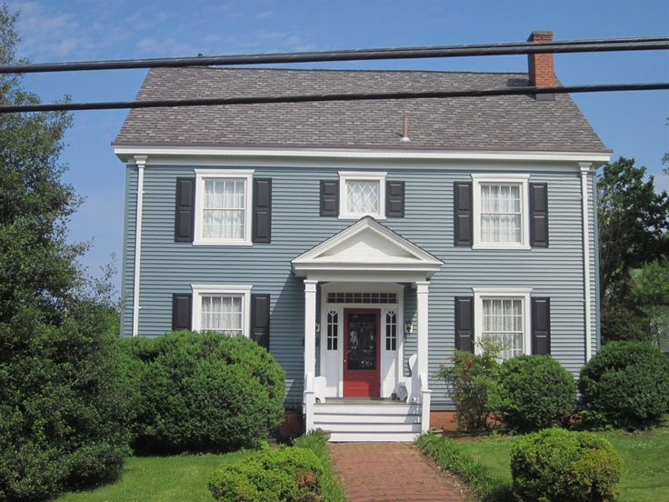 blue house, navy shutters, red door