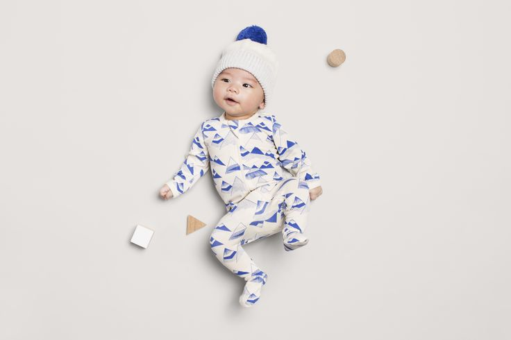 Cute little Oliver is wearing Wilson and Frenchy super comfy zip suit in the cutest indigo mountain print.