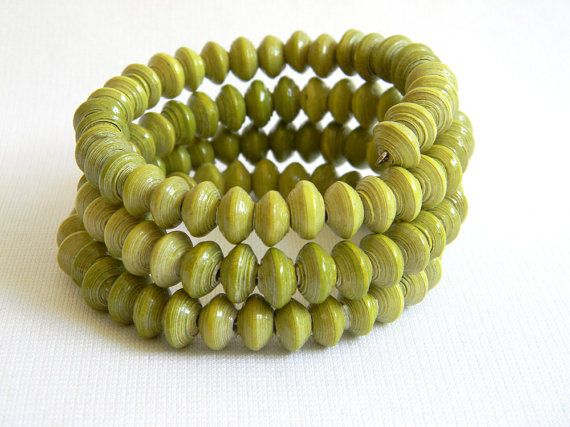 Memory wire bracelet created with well over 100 tiny saucer shaped paper beads hand-rolled by Nicaraguan women. The paper beads have been sealed in many coats of glossy water-based varnish.    One size fits most.    Item #1412    **Each item comes with a gift card that tells about the project. INTERNATIONAL SHIPPING: We will consider shipping internationally. Send us a conversation first so that we may quote you a shipping price.    Looking for loose beads? Visit Paper Bead Emporium…